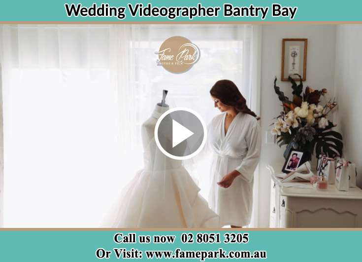 Bride looking at her dress Bantry Bay NSW 2087