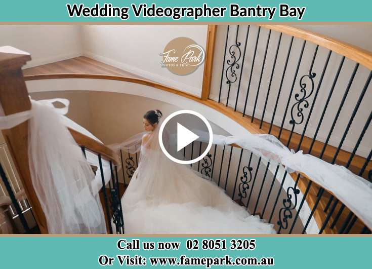 Bride walking down the staircase other Bantry Bay NSW 2087