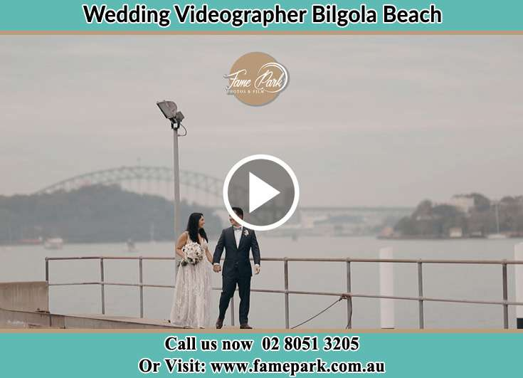 Bride and Groom looking at each other while walking in the shore Bilgola Beach NSW 2107