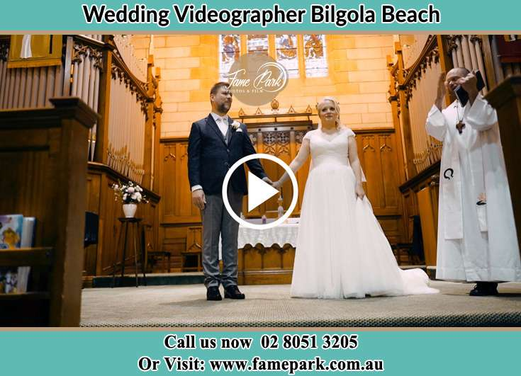 Bride and Groom hold hands at the altar Bilgola Beach NSW 2107