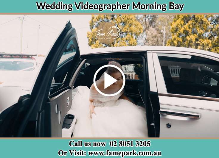 Bride getting out of the bridal car Morning Bay NSW 2105