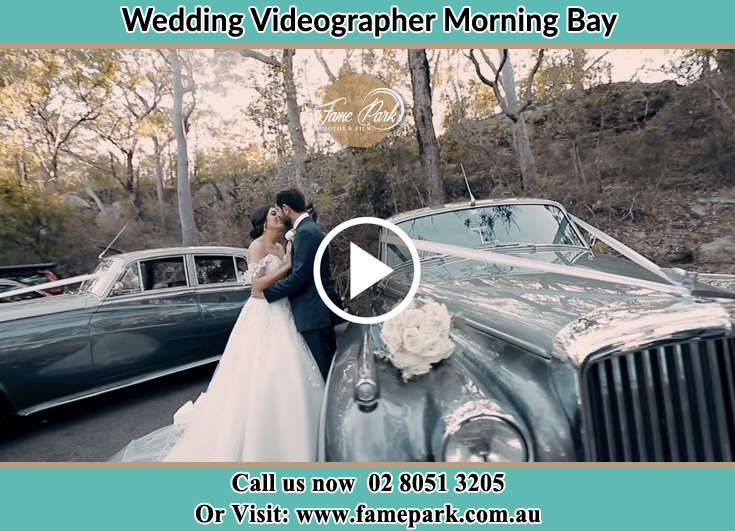 Bride and Groom kissed near the bridal car Morning Bay NSW 2105