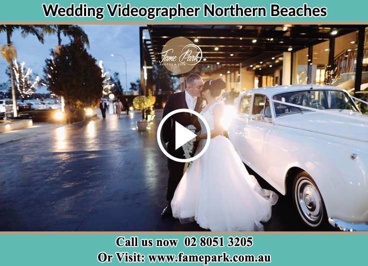 The couple besides their bridal car Northern Beaches